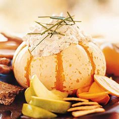 Pumpkin Dip Use autumn bounty as serving dishes and punch bowls. We love this recipe for Baked Pumpkins with Wild Rice Stuffing.