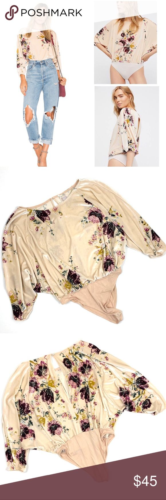 Free People cream Velvet Slouchy Babe Bodysuit Free People Velvet Slouchy Babe Bodysuit in Neutral Combo. Create the perfect tucked-in bohemian look in this slouchy velvet bodysuit illustrated in pretty flowers. Snaps between legs. Bateau neck. Three-quarter dolman sleeves. 92% polyester, 8% spandex. Hand wash, line dry. Never worn Free People Tops Blouses