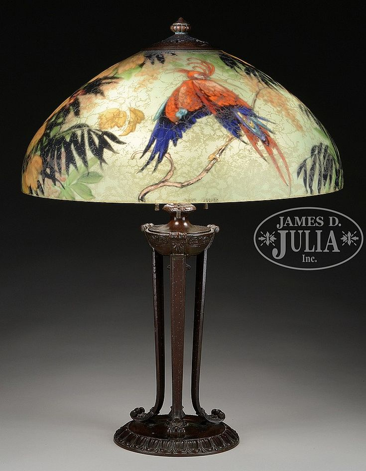 Handel table lamp has reverse painted dome shade with brightly colored  exotic bird on front and