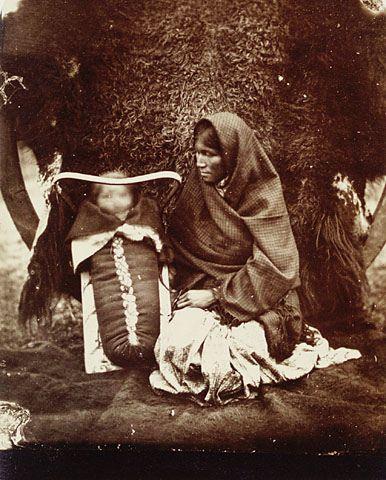 An Ojibwa woman and child, Red River Settlement, Manitoba, 1895. / Une femme ojibwa et son enfant, An Ojibwa woman and child, Colonie de la Rivière-rouge , 1895. | by BiblioArchives / LibraryArchives
