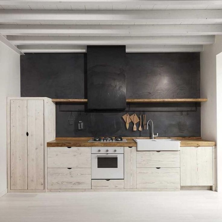 White washed kitchen furniture with a black paint wall