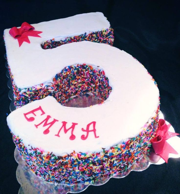 #5 carved sprinkle cake with fondant bows