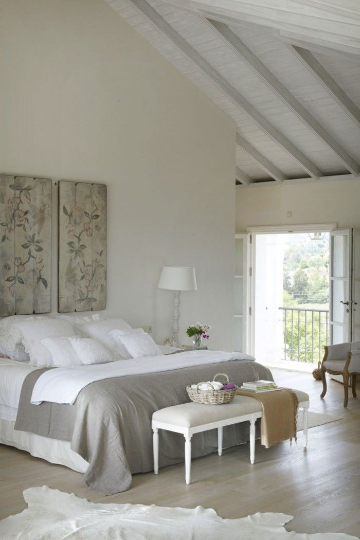 Vaulted ceiling in white and gray beach house bedroom via Scout & Nimble