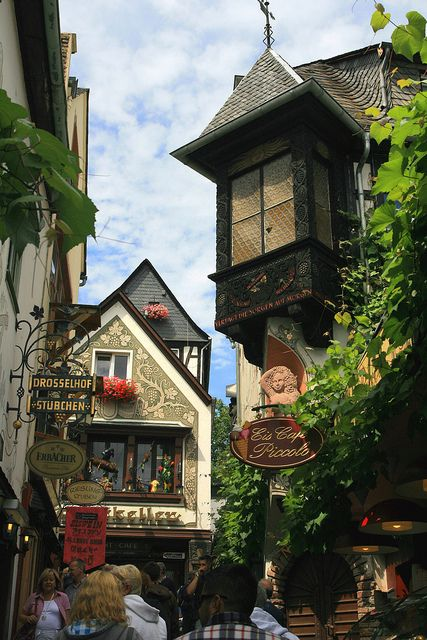 Strolling on Drosselgasse street in Rüdesheim am Rhein, Hesse, Germany  Rudesheim is one of the great tourist towns.. great clock stores there
