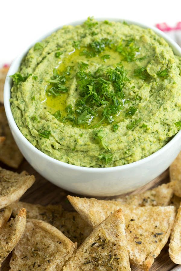 Lemon Spinach Hummus includes everything you love about hummus with the addition of spinach to create this snack packed with green goodness. Serve with homemade baked seasoned pita chips!