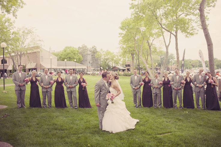 Love this #weddingparty shot with the bridesmaids and groomsmen standing every other! Photo by Roee. #MinneapolisWeddingPhotographer