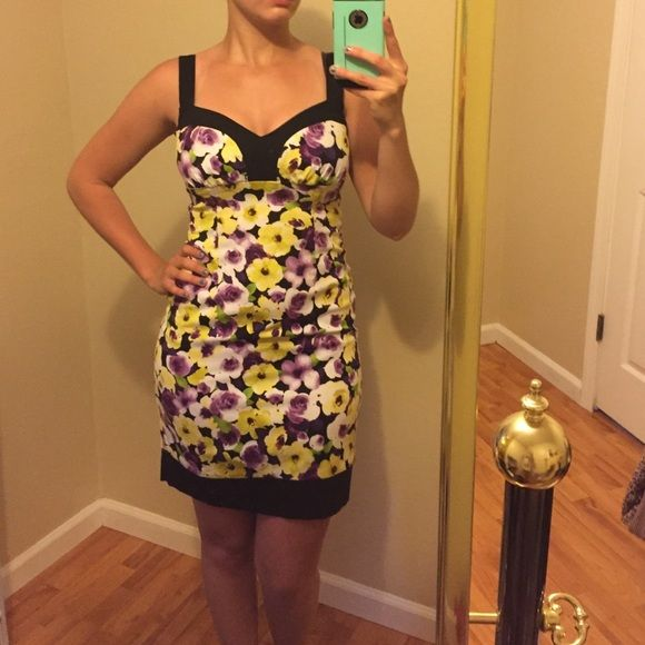 Floral dress Purple and yellow floral pattern on very form fitting dress. Zips up in the back and has very thick sturdy straps. Stretchy material. B. Smart Dresses