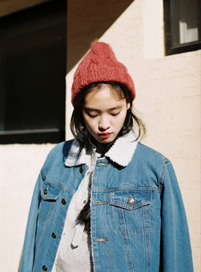 Red wooly hat, denim jacket with sheep collar