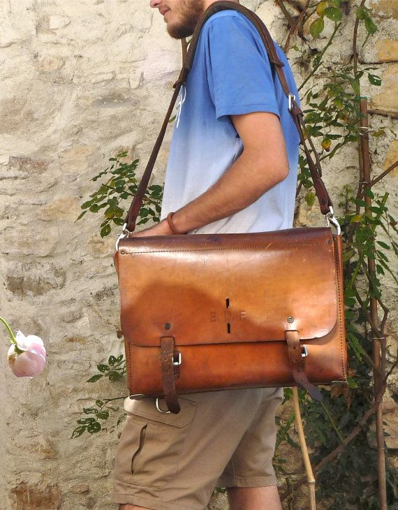 Gorgeous bag with time worn patina, very nice vintage style. Strong and firm in structure, the leather is very thick and hardened. Beautiful and rich tawny in color.   Superbe briefcase with 5 layers of compartments. The second layer is composed of 7 small compartments to put phone, camera, glasses etc.  On the front are engraved 3 letters, EDF, which means Electricité De France.  This huge bag used to EDF electricians, they put all their tools and small electrical equipment.  It is a…