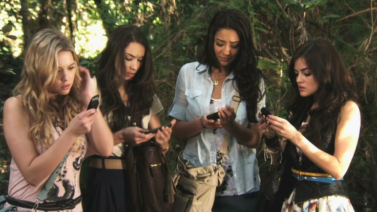 Hanna, Spencer, Emily, and Aria getting a text from A in the woods