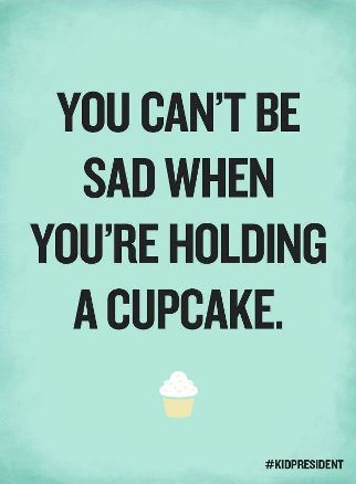 Correction... You can be sad holding or eating a cupcake, but it is very difficult.