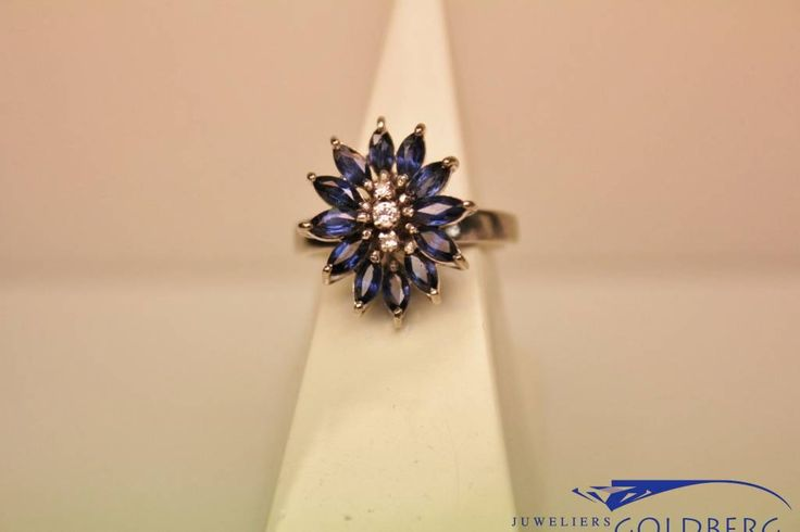 Beautiful and very special vintage 14 carat white gold fantasy rosette ring with sapphire and diamond. Only € 150! - Goldberg Juweliers http://www.goldbergjuweliers.nl/en/vintage-14-carat-white-gold-fantasy-rosette-ring.html