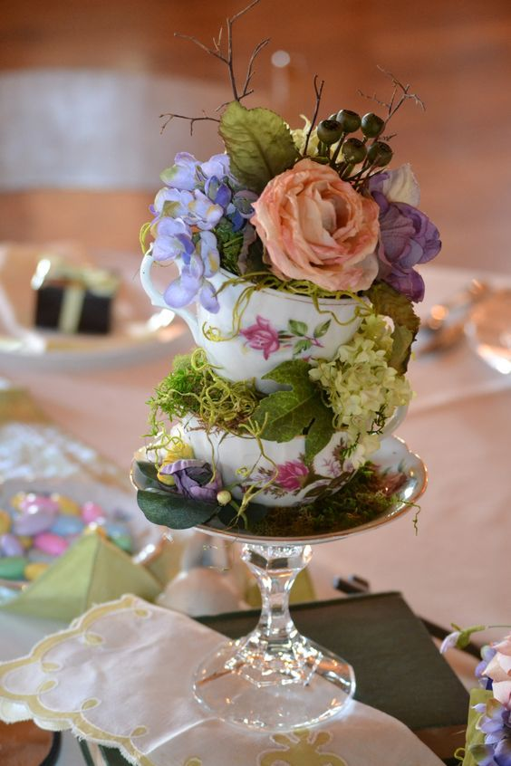 I made topsy turvy teacup table arrangements for all ...