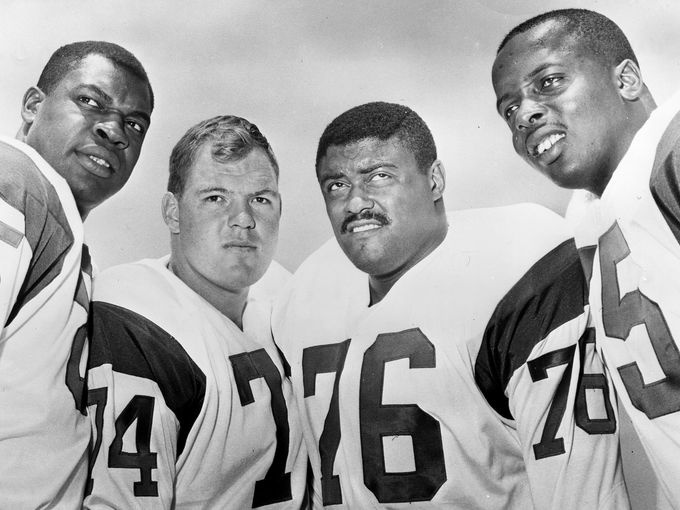 This 1964 handout provided by NFL photos, shows the Los Angeles Rams defensive front four, known as the Fearsome Foursome. from left to right are Lamar Lundy (85), Merlin Olsen (74), Rosey Grier (76), and Deacon Jones (75).