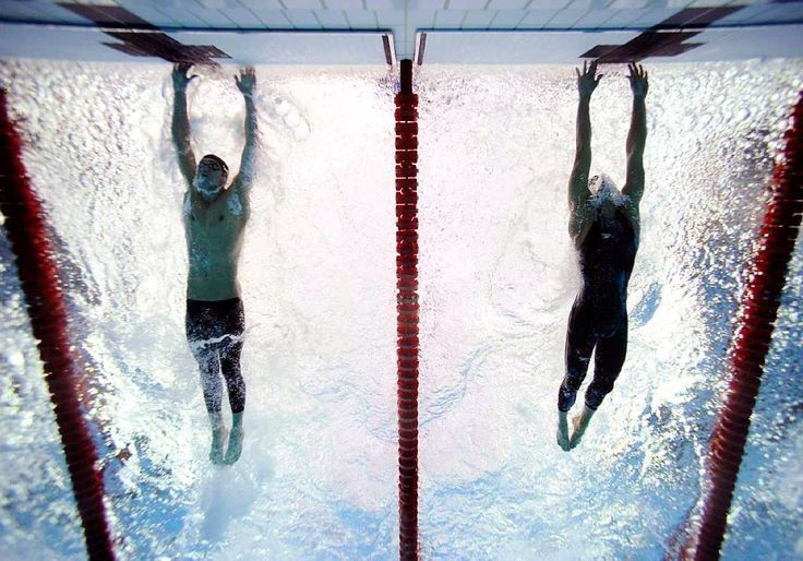 Beijing Olympics, Aug. 16, 2008   American swimmer Michael Phelps out-touches Serbian swimmer Milorad Cavic by 0.01 seconds at the finish of the 100-meter butterfly final. It was the seventh of Phelps' record eight golds during the Olympics.