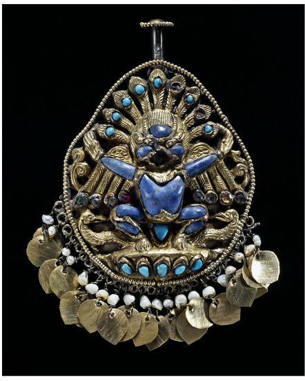 Silver and lapis luzuli earring featuring Garuda, the vehicle of the Hindu deity Vishnu. Nepal, 18th or 19th century. l Victoria and Albert Museum #jewellery