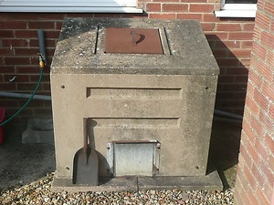 Concrete coal bunker in the back garden, I remember the coal man coming thru to fill it !