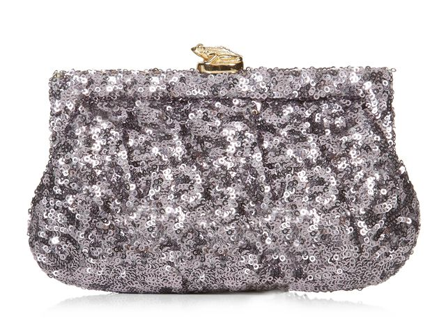 A small but lovely Margot Pewter silk frame bag from Wilbur & Gussie. This bag has been beautifully designed with a mauve sequin fabric. Bag has a crystal encrusted polished solid brass Frog clasp, optional gold chain and a inner pocket. View more bags from our Wilbur & Gussie Collection at: http://www.baroqueboutique.co.uk/wedding-shoes-and-accessories/