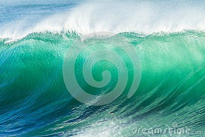 Ocean blue wave wall upright crashing hollow breaking sea water energy power of nature