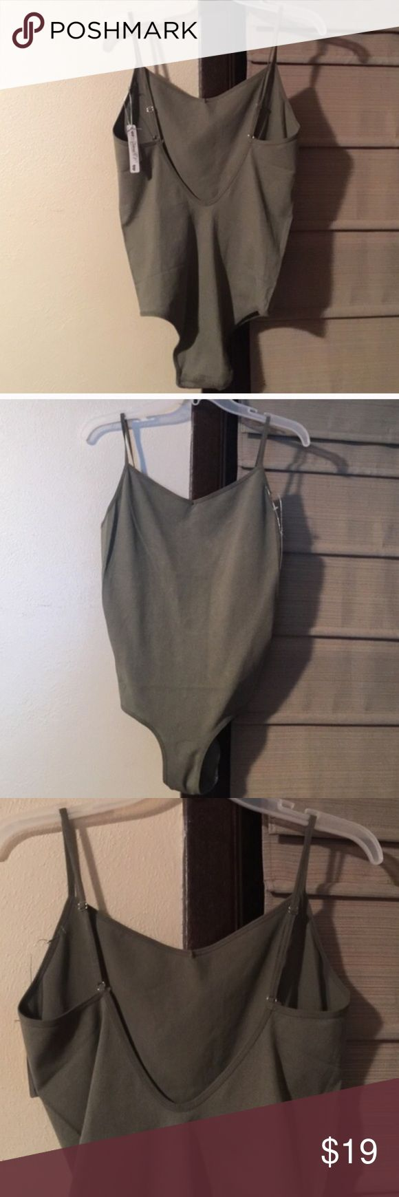 Last 1! NWT Olive Low Back bodysuit stretchy Brand new with tags. Not yeezy, branded for promo. Super cute and sexy extra low back stretchy one piece bodysuit. Size is a M/L, more on the medium side but super stretchy form fitting material. Straps adjustable and back is super low (measure 2-3 inches above your belly button and that's about where's it hits in the back) great w/ a pair of jeans or high waist skirt. Olive green bodysuit one piece. Price firm, sold several of these and found…