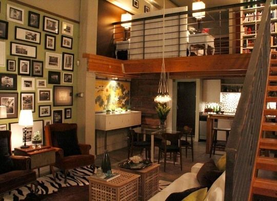 industrial loft turned into apartment. I love the warmth mixed with the rawness