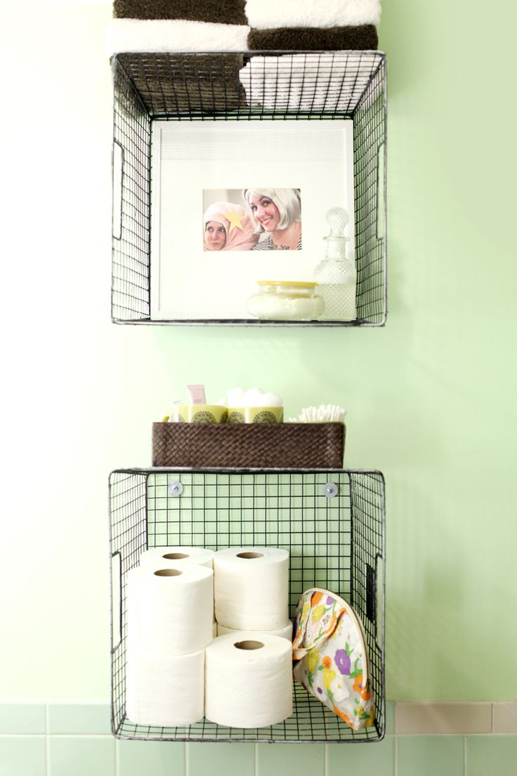 Hanging wire baskets for  vertical storage is such a cute way to organize your bathroom! Click through for styling tips and hanging directions...