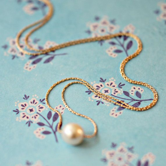 A pearl necklace is a pretty and timeless gift for a bridesmaid.