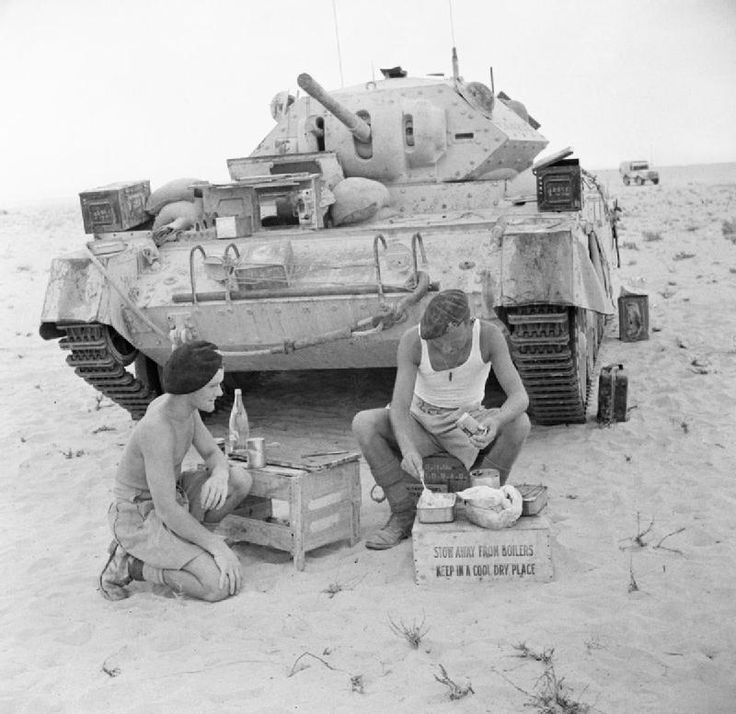 SEP 19 1942 An Officer adjusts to life in the Desert The crew of a Crusader tank prepare a meal in the Western Desert, 20 September 1942.