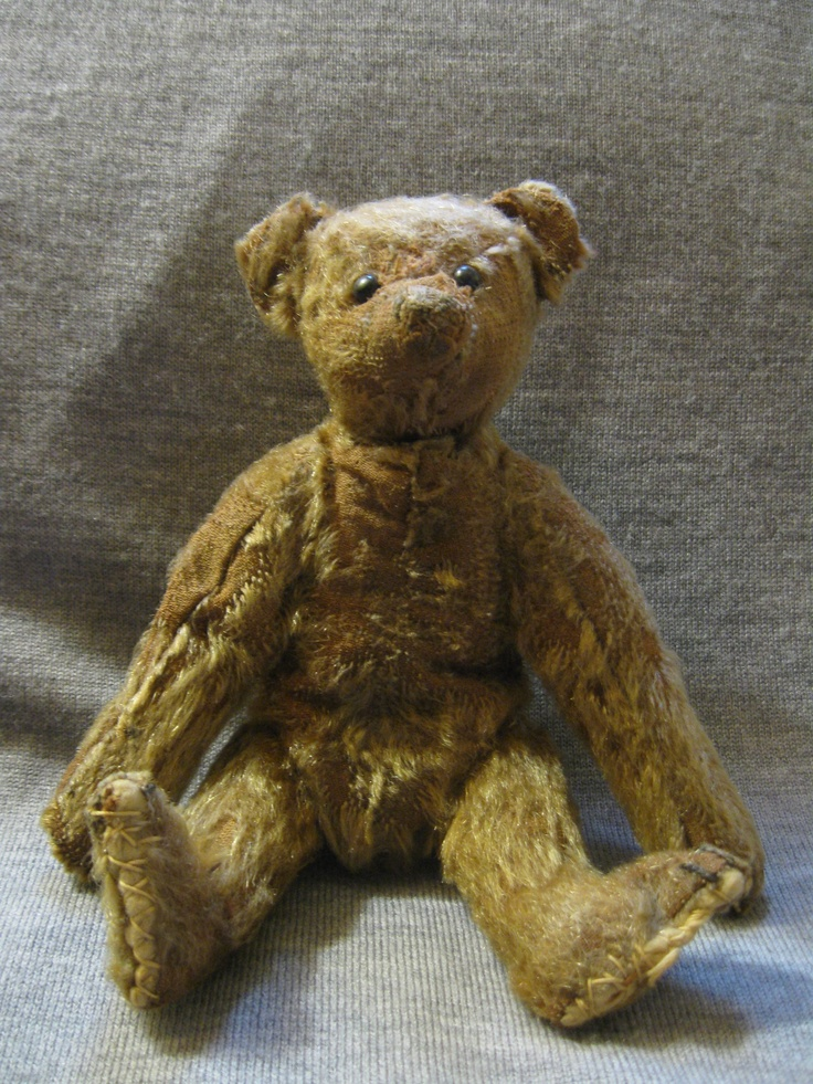 Circa 1900 Steiff Teddy Bear. Made of mohair. Bear has shoe button eyes and remains of a sealing wax nose.