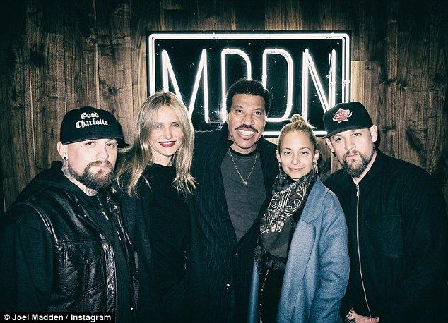 Famiy first: Joel Madden posed with his wife Nicole Richie, and Lionel Richie, Nicole's father, and also his twin brother Benji and his wife Cameron Diaz on Wednesday