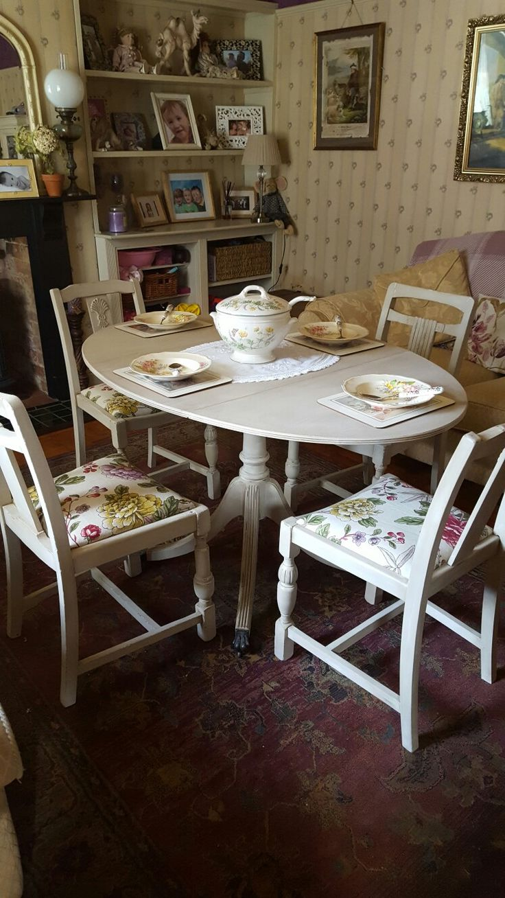 Shabby chic dinning table and chairs painted in Autentico cafe au lait then dried brushed in Autentico rose white and waxed with a mixture of colours. Fabric by morris and Co. Hand painted and recovered by Laura Milner