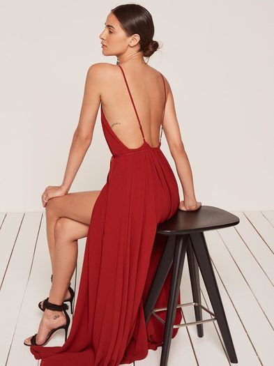 For when you pretend to try to catch the bouquet. This is an open back, wrap dress with a high slit and low v neckline.