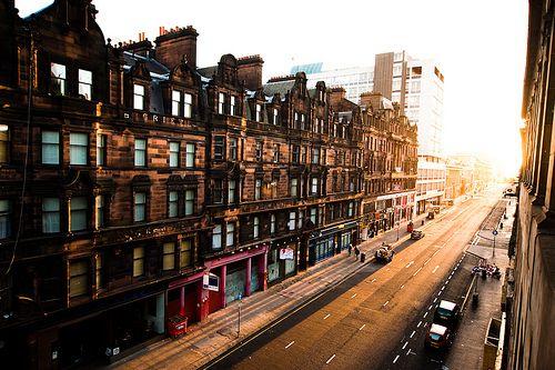 Glasgow, Scotland : 'miles better' : yellow gemstone sun - centered - avenue rhinestones straight line