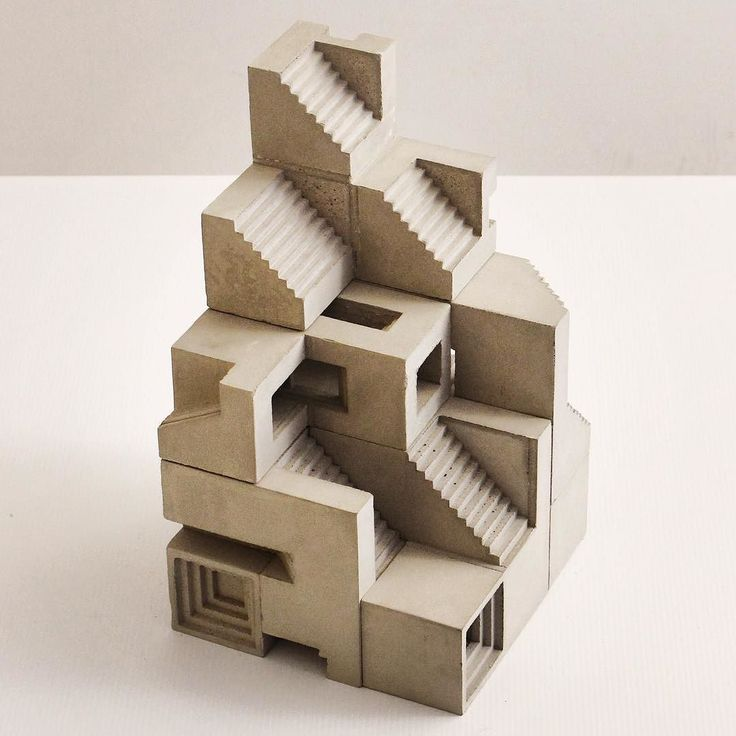 Next top architects, Soma Cube no.6 Variation on the 3x3 cube Modular concrete sculpture inspired by the Soma cube geometry made of 7 different polycubes. There are 240 possible solutions to create a 3x3 cube. They can also be assembled freely to create various 3D shapes.