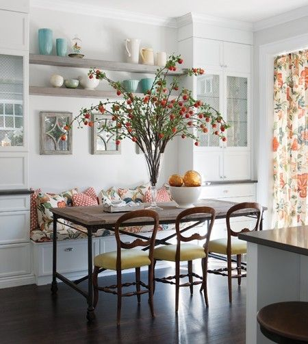 built in bench with a simple table and simple chairs. Beautiful informal dining room seer up. I love the center piece. Are those strawberry branches?