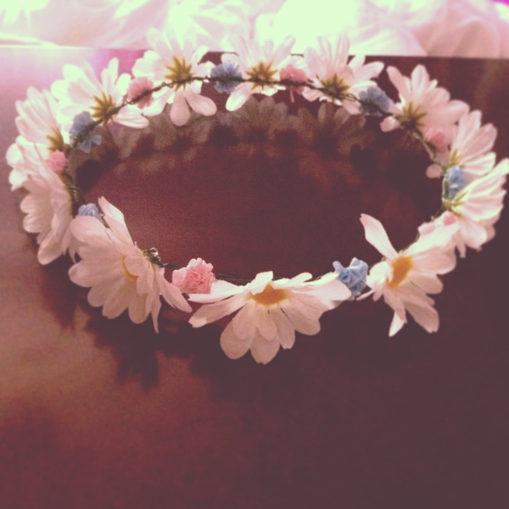 homemade flower crown using hot glue, fake flowers, and flower wire.
