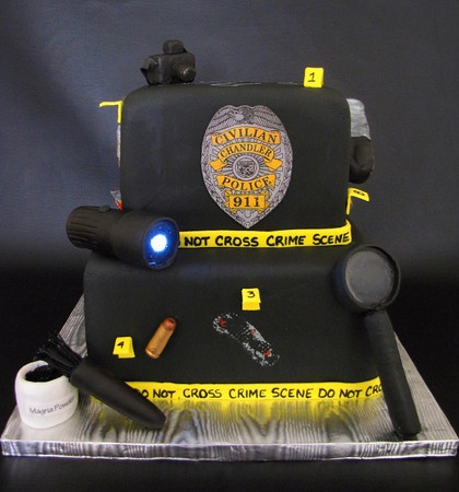 "A Crime Scene! Chandler Forensic Unit Crime Scene cake is White Chocolate Sourcream cake with Chocolate Ganache filling and covered in fondant. Crime scene tools are made out of rice cereal treats and covered in fondant. All ""glass"" is made out of poured sugar. Flashlight has a real working light in it."