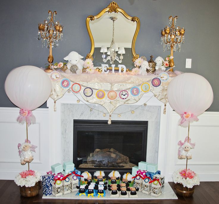 The best part is when the kids wake up in the morning of Eid to find their gifts wrapped and stacked in front of the fireplace. Make this Eid extra special for your little ones. #Eid #Eid Al-Adha #Kids #Mantel #Fireplace #decorations #Sheep #Gifts