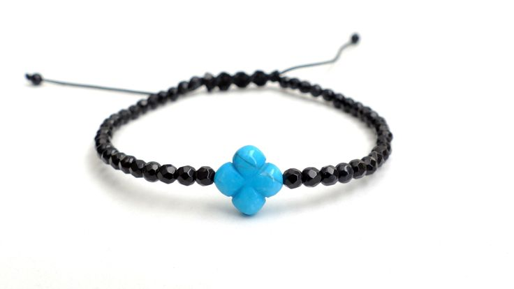 Macrame bracelet from Black Onyx and a Cross from Howlite Price:14€
