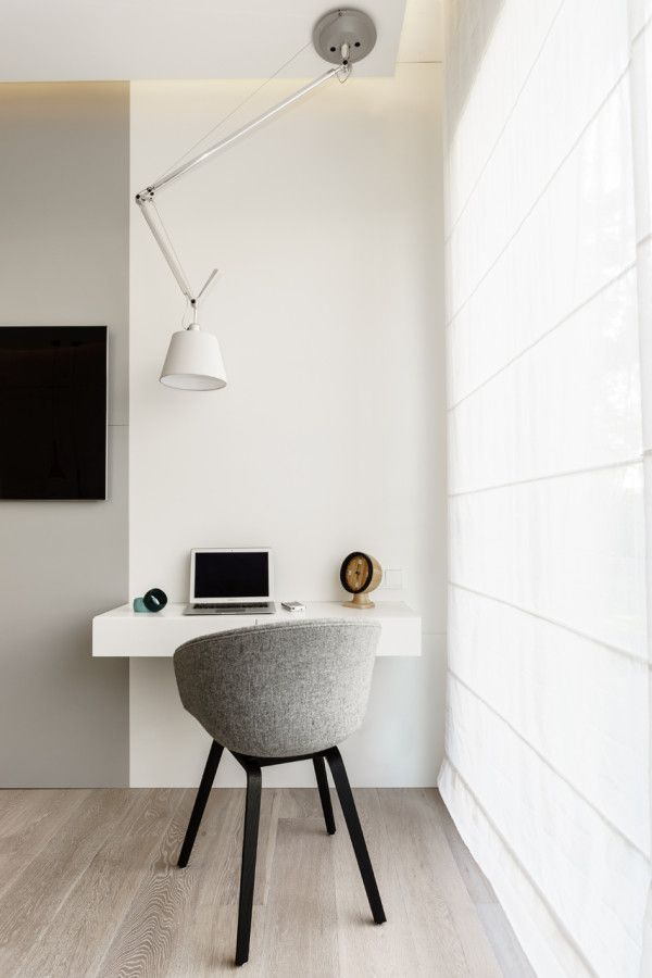 This Apartment Will Inspire You To Go Bold With Your Decor #refinery29 http://www.refinery29.com/design-milk/32#slide10 An overhead light makes a statement, while still having a practical use for the workspace.