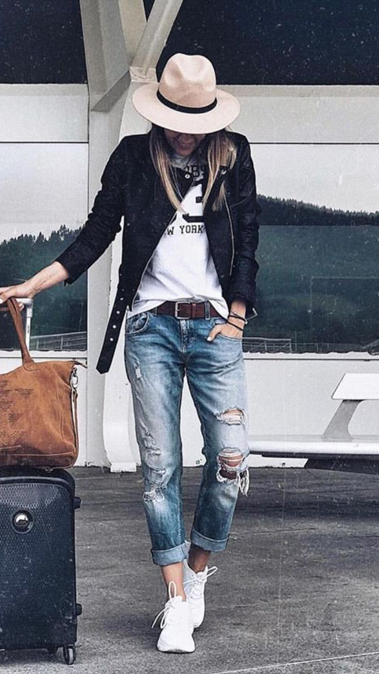 Create this with teal graphic tee, gray distressed moto, boyfriends and sneaks. Don't know if I'd use it as an airport outfit though