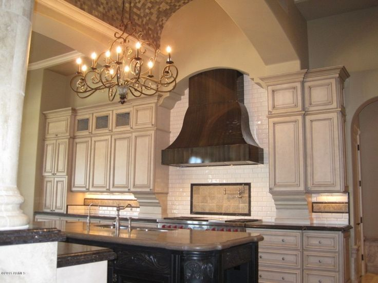 Unique Kitchen Hood And Arched Ceiling