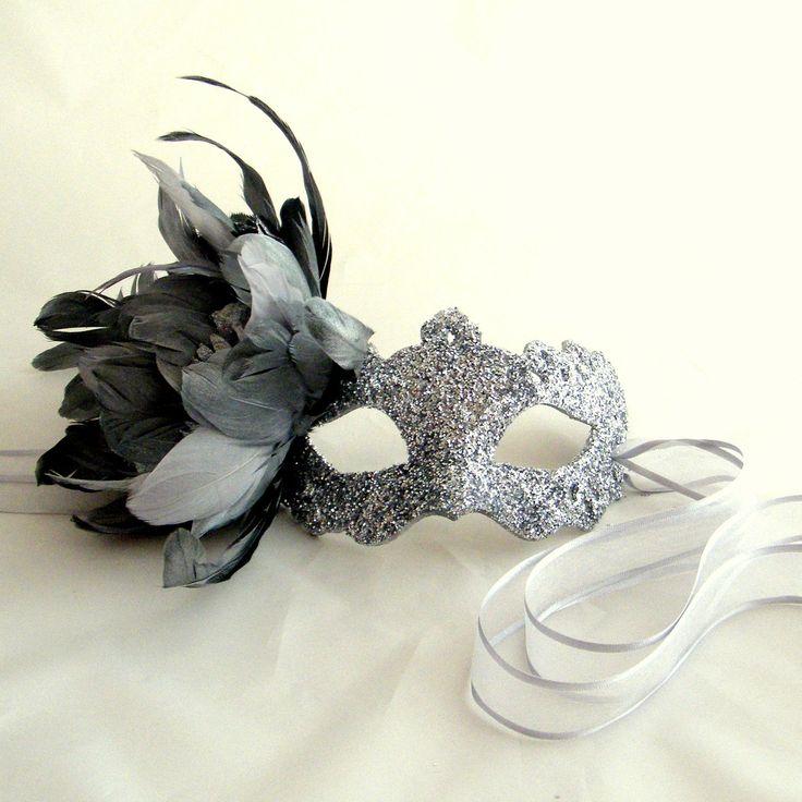 Luxury Silver Feather Supernova Venetian Masquerade Masked Ball Mask. $79.99, via Etsy.