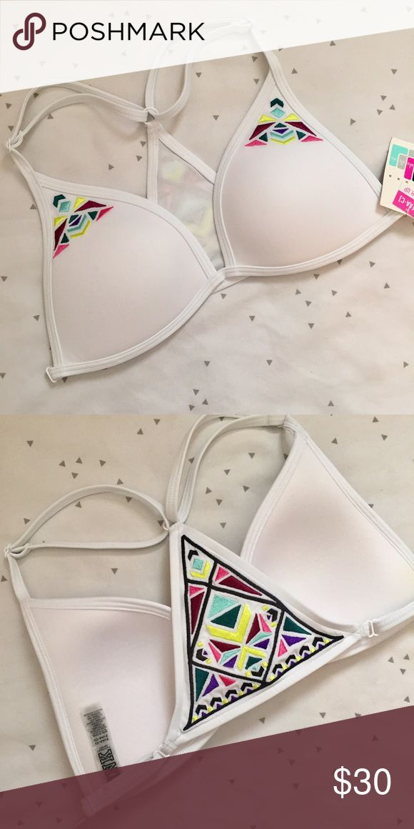 VS PINK White Triangle Bikini Top VS PINK WHITE TRIANGLE BIKINI TOP •Super cute with Push Up! •NWT✨ •Size small •Great Tribal accent and matches various bottoms! •Fast Shipping! •Any questions? Ask away! Happy Poshing!     Related: VS, VSX, Victoria's Secret, PINK, swim, Bikini, swimsuits, bathing suit, beachwear, swimwear, two piece, one piece, follow me, follow game PINK Victoria's Secret Swim Bikinis