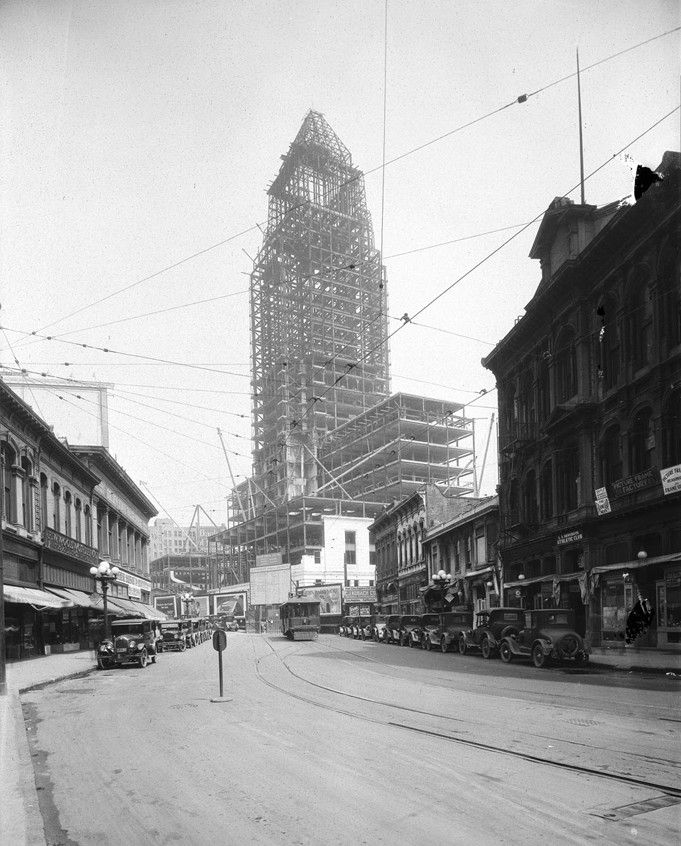 (1927)*# - View of City Hall under construction in 1927.      Historical Notes  City Hall's distinctive tower was based on the purported shape of the Mausoleum of Mausolusand shows the influence of the Los Angeles Public Library, completed soon before the structure was started.  An image of City Hall has been on Los Angeles Police Department badges since 1940.^*