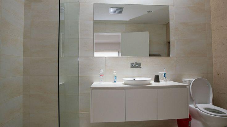 Ceiling height bathroom tiles, white bathroom