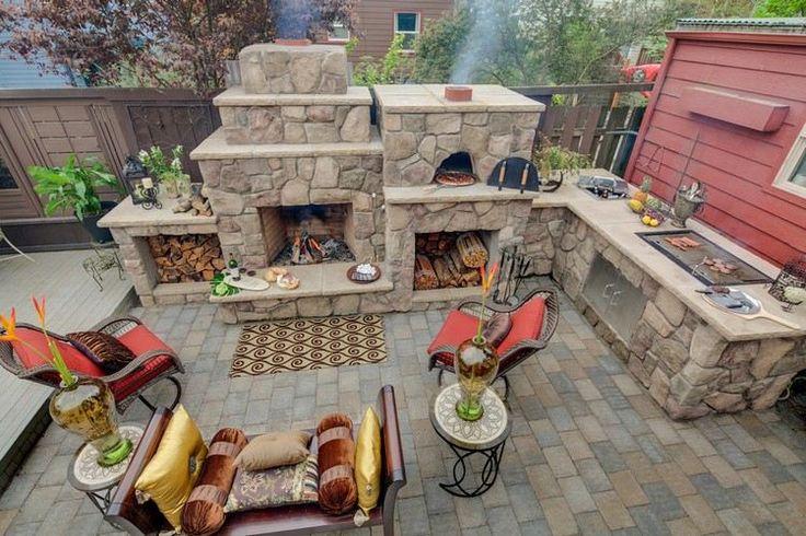 Naturstein Kamin und Outdoor Küche mit viel Stauraum