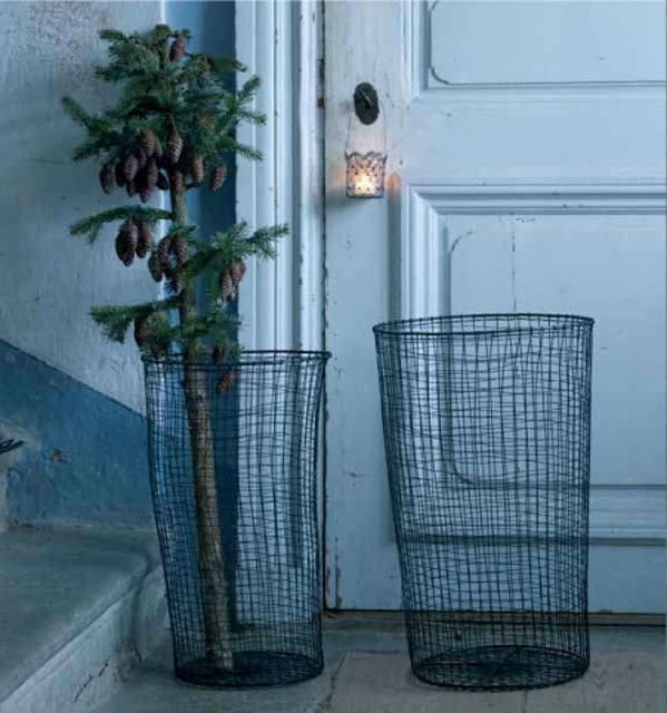 Wired bins and little glass candle jars on door handles (Affari)