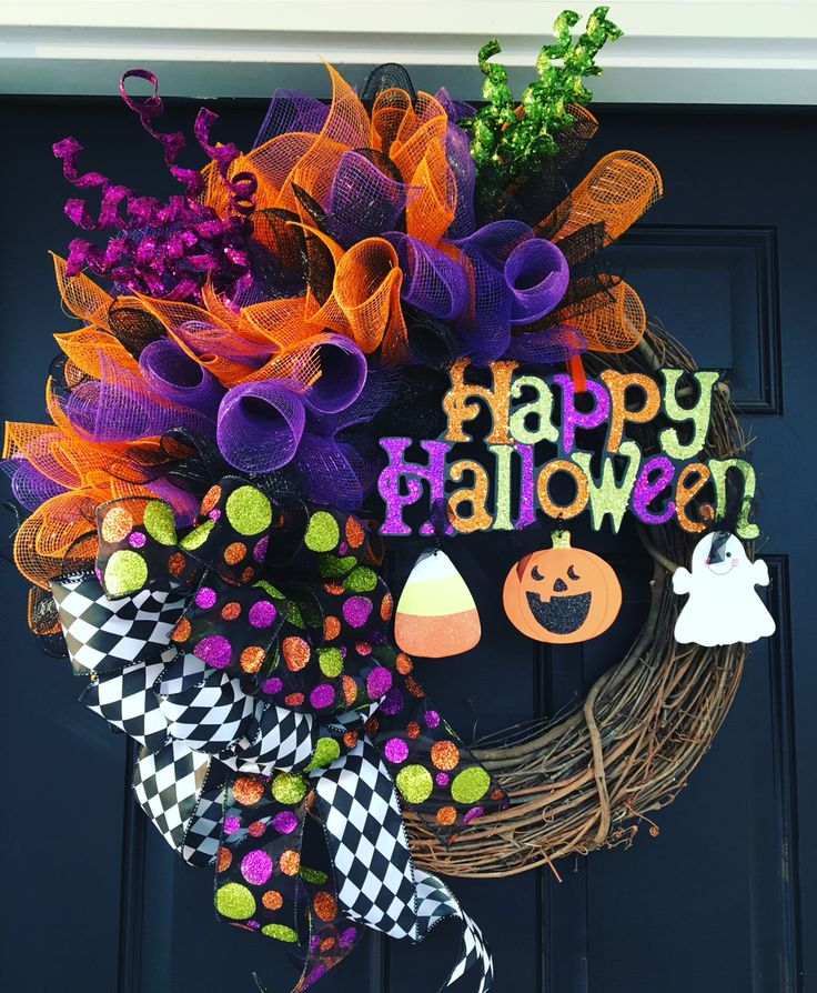 $70 FREE SHIPPING! Etsy: HomeByTheHolidays   Add Halloween flair to your front door with this majestic grapevine wreath.  Wired funky bows and Halloween plaque are the focal points of this wreath.  Glittery picks and festive ribbon make this wreath the perfect accessory for your front door.
