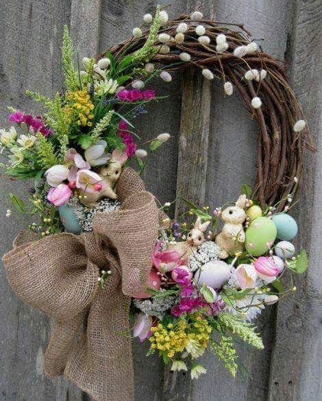 Decorated Little Bunnies Peeping From Wreath With Tulips